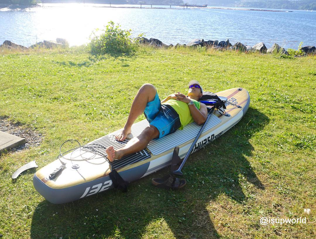 man lays on Thurso Surf Waterwalker all-around SUP thinking about paddleboard vs kayak which should you buy
