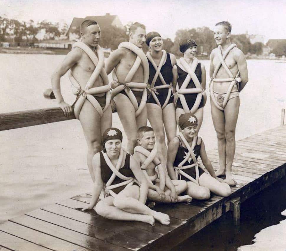 group of people wearing bike tubes as lifejackets