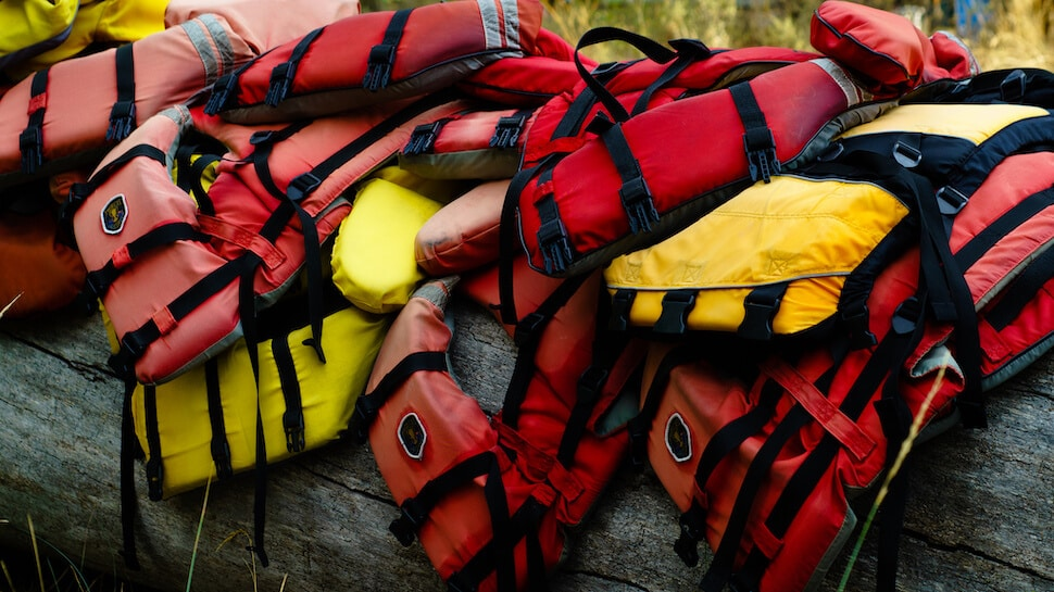 difficult to choose a life jacket for stand up paddleboarding from a pile of lifejackets