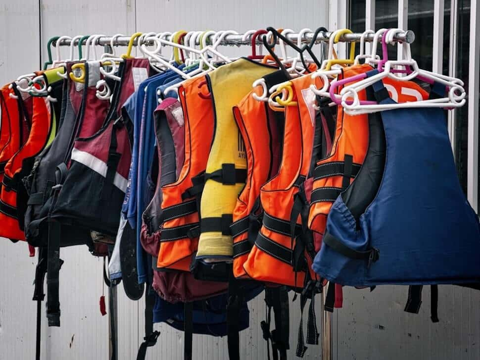lifejacket choices for SUP drying on hangers