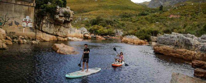 Couple paddles river on Thurso Surf Waterwalker All-around iSUPs