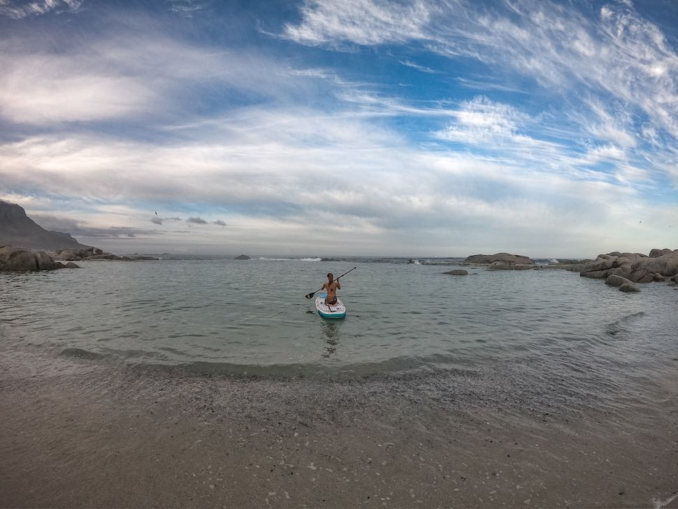 Woman knee paddles on Thurso Surf Tranquility Yoga stand up paddleboard