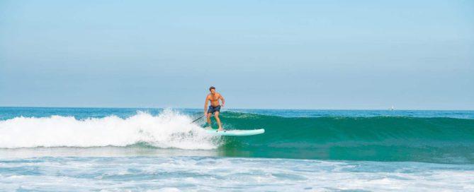 Man SUP surfing with Thurso Surf Waterwalker All-around SUP