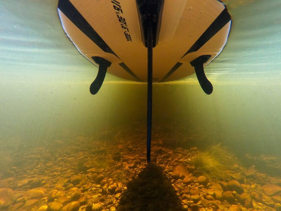 underwater view of the bottom of a Thurso Surf stand up paddleboard