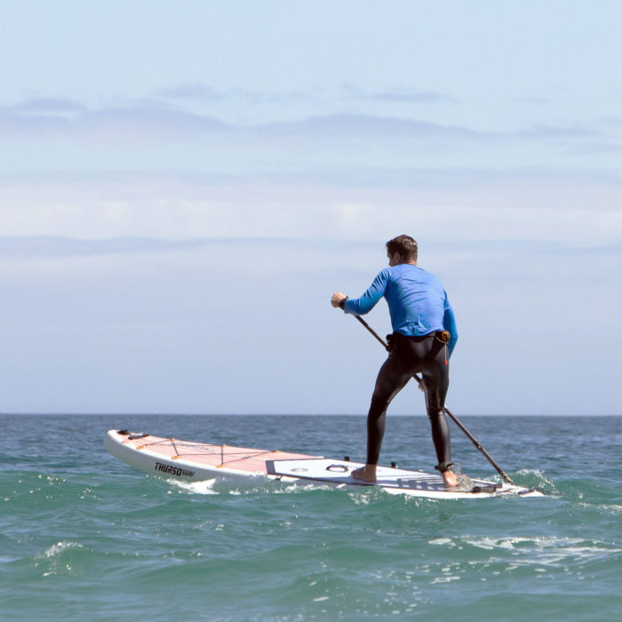 touring sup board thurso surf expedition man pivot turn step back