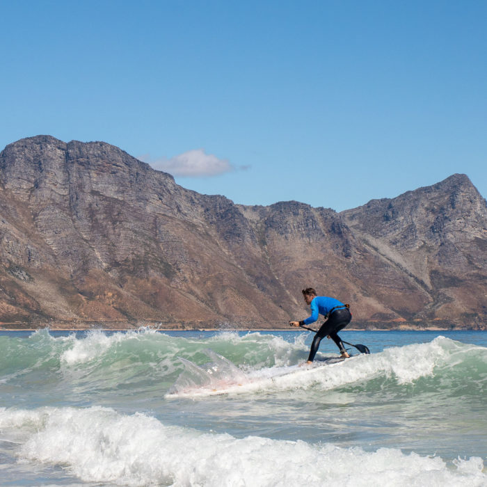 touring sup board thurso surf expedition man surfing waves