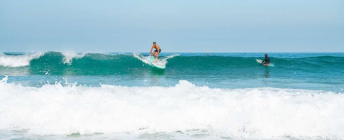 Following SUP surfing safety, man catches wave on Thurso Surf Waterwalker All-around SUP