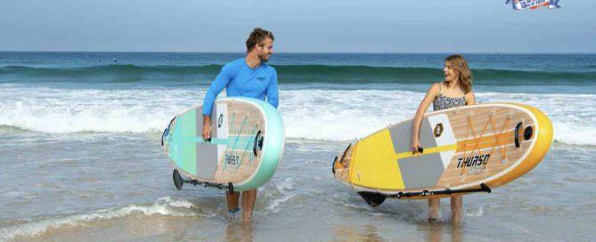 Man and woman walk with award winning Thurso Surf Waterwalker All-around SUP