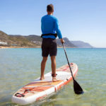 thurso surf waterwalker 132 SUP 2021 crimson man paddling landscape