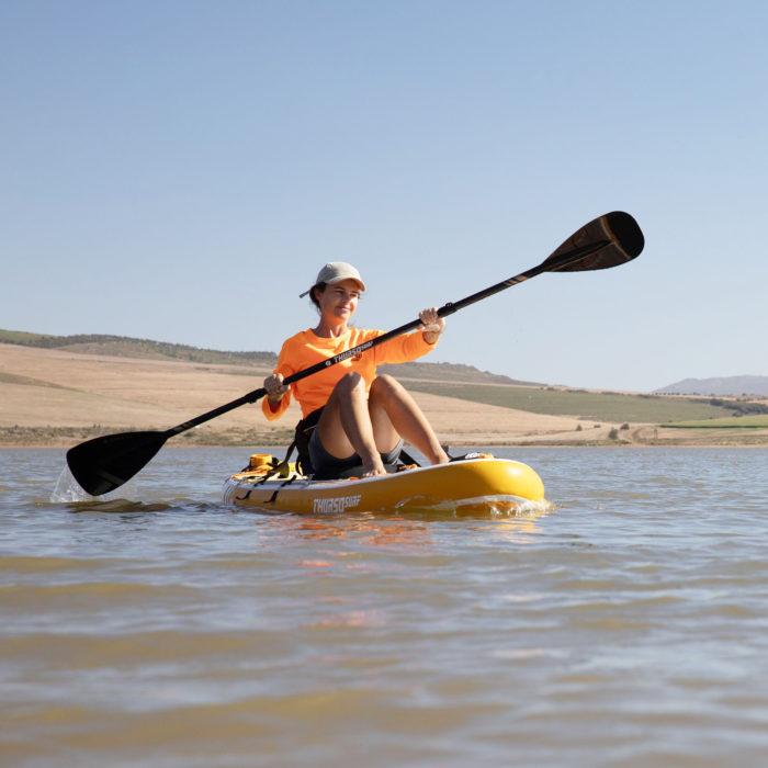 thurso surf waterwalker 126 SUP 2021 tangerine woman kayaking paddling