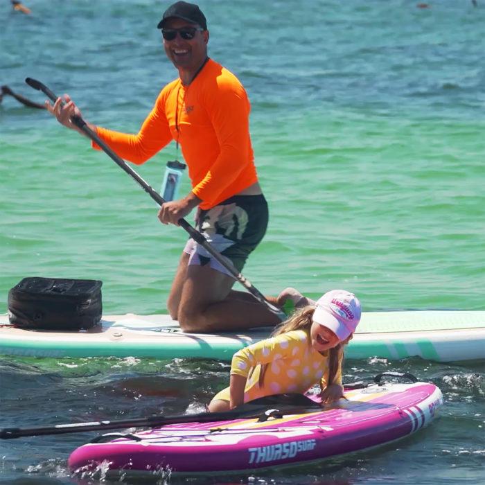thurso surf prodigy magenta paddle board jumping on board