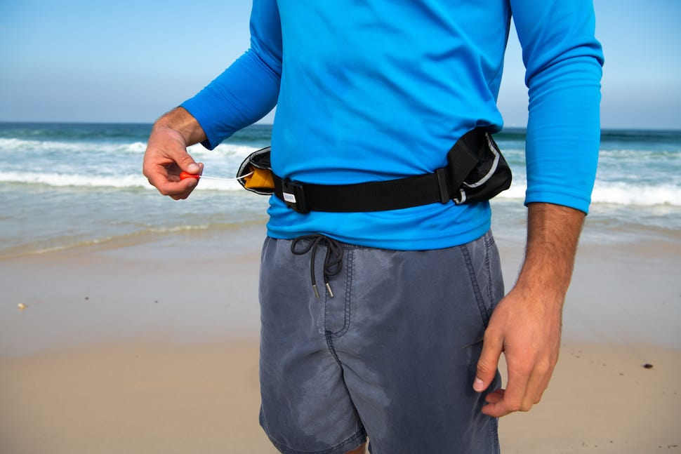 man wears an inflatable lifebelt for SUP safety