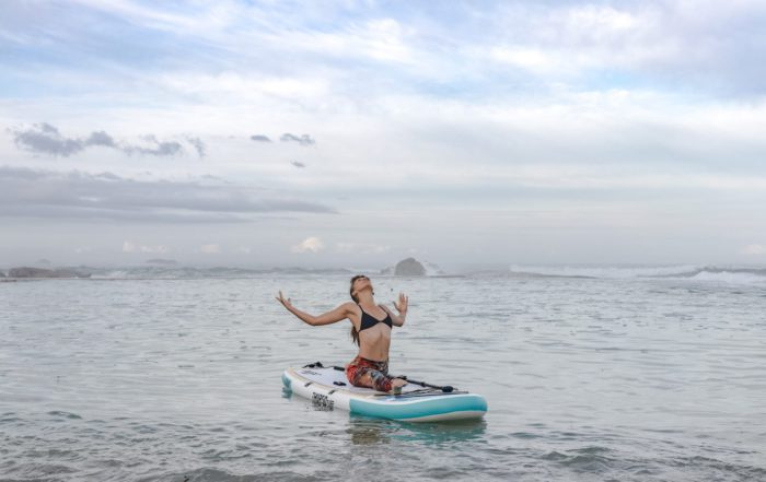 woman moves through yoga sequence on Thurso Surf Tranquility yoga SUP