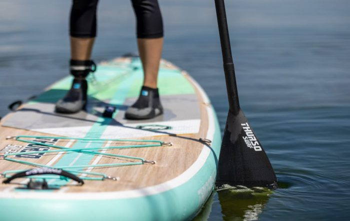 Close up of a Thurso Surf SUP board and SUP paddle