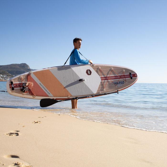 thurso surf waterwalker 132 SUP 2021 crimson man standing on shore