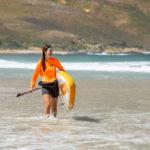 thurso surf waterwalker 132 SUP 2021 tangerine woman carrying walking