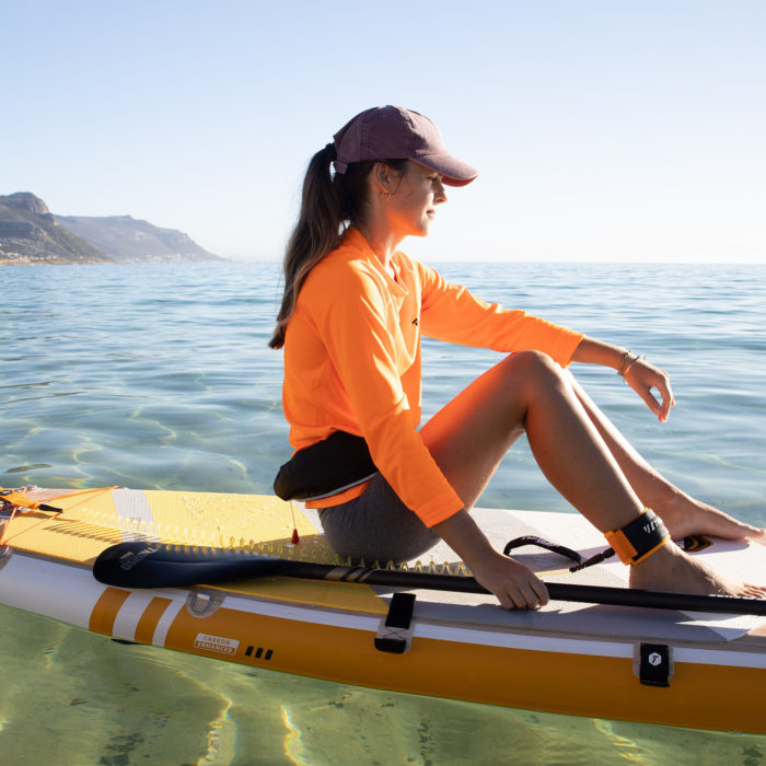 thurso surf waterwalker 132 SUP 2021 tangerine woman sitting on board