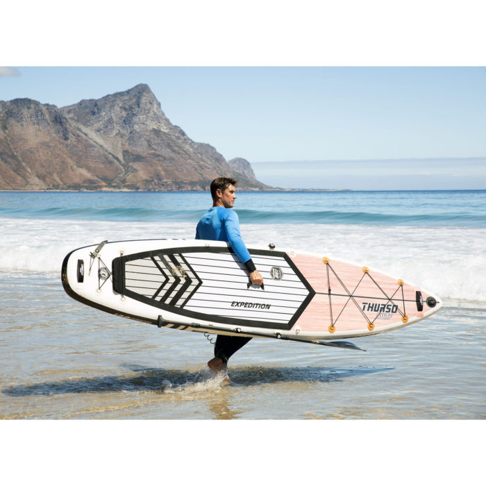 touring paddle board thurso surf expedition man carrying sup