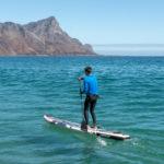 touring sup board thurso surf expedition man paddling ocean