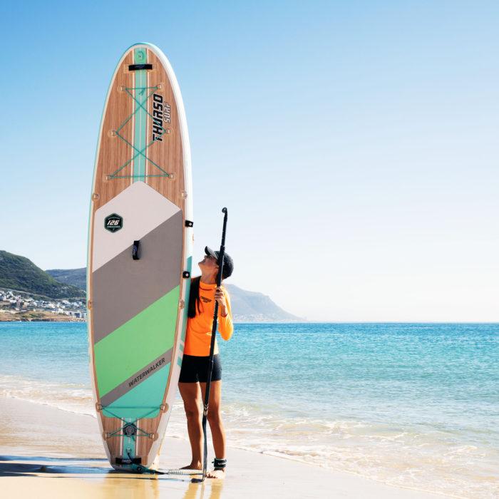 thurso surf waterwalker 126 2021 turquoise woman standing beside the board 2
